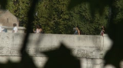 Tourists crossing Rome bridge Stock Footage