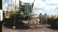 Stock Video Footage of Drilling for OIL WELL RIG Industry Drilling GAS 1965 Vintage Film Home Movie 690