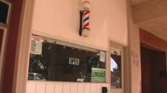Stock Video Footage of Small Town Barber Shop Entrance