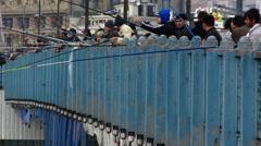 Turkey Istanbul Turkish people fishing Galata bridge - stock footage