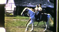 Teens Ride Galloping Horses Boy Girl Riding 1960s Vintage Film Home Movie 657 Stock Footage