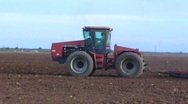 Stock Video Footage of Tractor Plowing Farm Field Evening 1