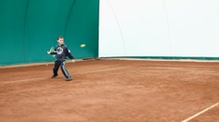 Boy playing tennis Stock Footage