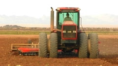 Approaching Tractor Plowing Imperial Valley Farm Field Stock Footage