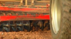Plow Blades Tilling Soil On Farm- Extreme Close Up Stock Footage