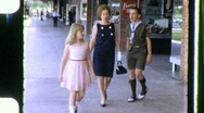 Stock Video Footage of Family Shops Main Street USA Circa 1973 (Vintage Film Home Movie) 661