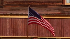 United States Flag Flying In Small Town 1 Stock Footage
