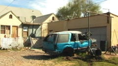 Wrecked Car Next To Run Down House Stock Footage