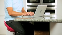 Mature Couple with Laptop Having Success Online Stock Footage