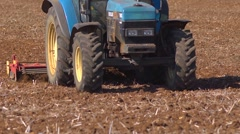 Close up of a powered harrow coming towards camera. Slow motion Stock Footage