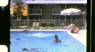 Stock Video Footage of Family Vacation at the Motel Pool Circa 1960 (Vintage 8mm Home Movie) 666
