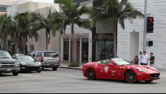 Ferrari luxury cars on Rodeo Drive in Beverly Hills, Los Angeles, California Stock Footage