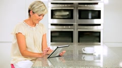 Mature Lady with Wireless Tablet Having Success Online Stock Footage