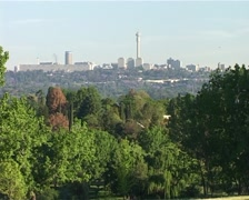 Stock Video Footage of Joburg Skyline Zoom out to Green Delta Park, GFSD