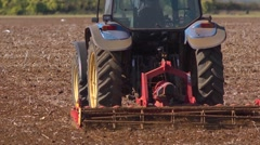 Close up of a powered harrow in action. Slow motion 2 Stock Footage