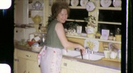 Stock Video Footage of Women WASHING DISHES Kitchen HOUSEWORK 1960s Vintage Film Retro Home Movie 669