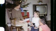 Stock Video Footage of Family Reading Together Christmas Circa 1970 (Vintage Film Home Movie) 670