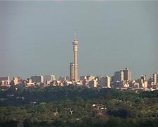Joburg Skyline and green, leafy Suburbs, GFSD - stock footage