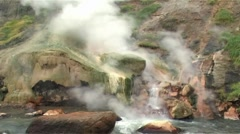 Geysers near the river - stock footage