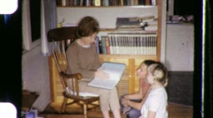 Mother READS To Children Reading Together 1970s Vintage Film Home Movie 672 Stock Footage
