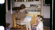 Stock Video Footage of Family Reading Together Circa 1970 (Vintage Film Home Movie) 672