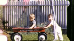 KIDS Pushing Baby Brother Red Toy Wagon 1950s Vintage Film 8mm Home Movie 685 - stock footage