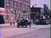 Model A car in parade--From 1950's film Stock Footage