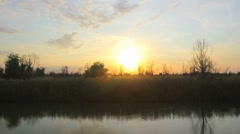 Timelaps sunset at the river Stock Footage