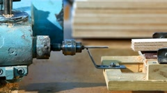Drilling a plywood from side at wood factory Stock Footage