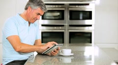 Mature Caucasian Male Using Wireless Tablet Stock Footage