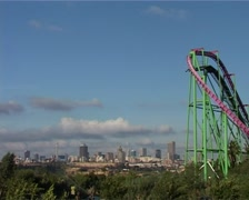 Joburg Skyline from Gold Reef City with roller-coaster in foreground, GFSD - stock footage