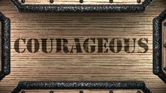 courageous on wooden stamp - stock footage