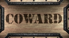 Coward on wooden stamp Stock Footage