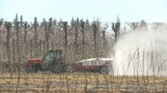 Spraying fruit trees with fungicide Stock Footage