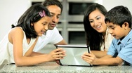 Asian Family Playing on Wireless Tablet Stock Footage