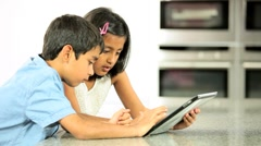 Young Asian Siblings Using Wireless Tablet Stock Footage