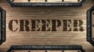 Stock Video Footage of creeper on wooden stamp