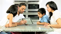Young Ethnic Family Using Laptop for Webchat - stock footage