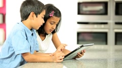 Asian Siblings Using Wireless Tablet Stock Footage