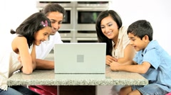 Asian Family Using Online Video Chat with Relatives Stock Footage