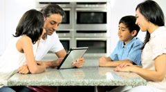 Young Asian Family Using Wireless Tablet Stock Footage