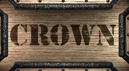 Crown on wooden stamp Stock Footage