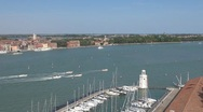 Stock Video Footage of A nice white lighthouse and many boats, yachts