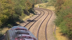 Cross country rail service travelling past underneath the camera. Stock Footage