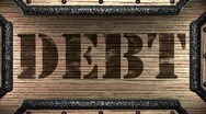 Debt on wooden stamp Stock Footage