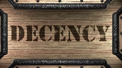 Decency on wooden stamp Stock Footage