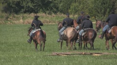 Stock Footage - Union Calvalry - ride med shot, turns then zoom out wide Stock Footage