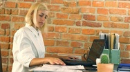 Businesswoman working on laptop in the office, steadicam shot HD Stock Footage