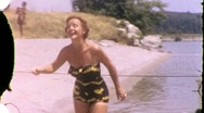 Woman At the Beach Circa 1955 (Vintage 8mm Home Movie Footage) 721 Stock Footage