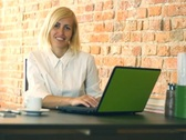 Happy businesswoman working on laptop in the office, steadicam shot NTSC Stock Footage